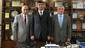Nezir Kinin Haç dönüşü Kaymakam Zeyit Şener'i ağırladı